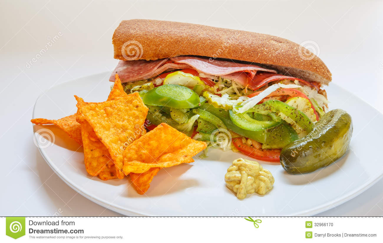 Italian Sub Sandwich With Pickle And Tortilla Chips Stock Photo ...