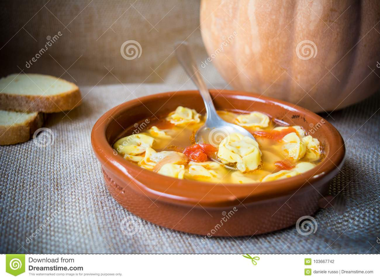 Italian traditional food called tortellini in brodo with bread