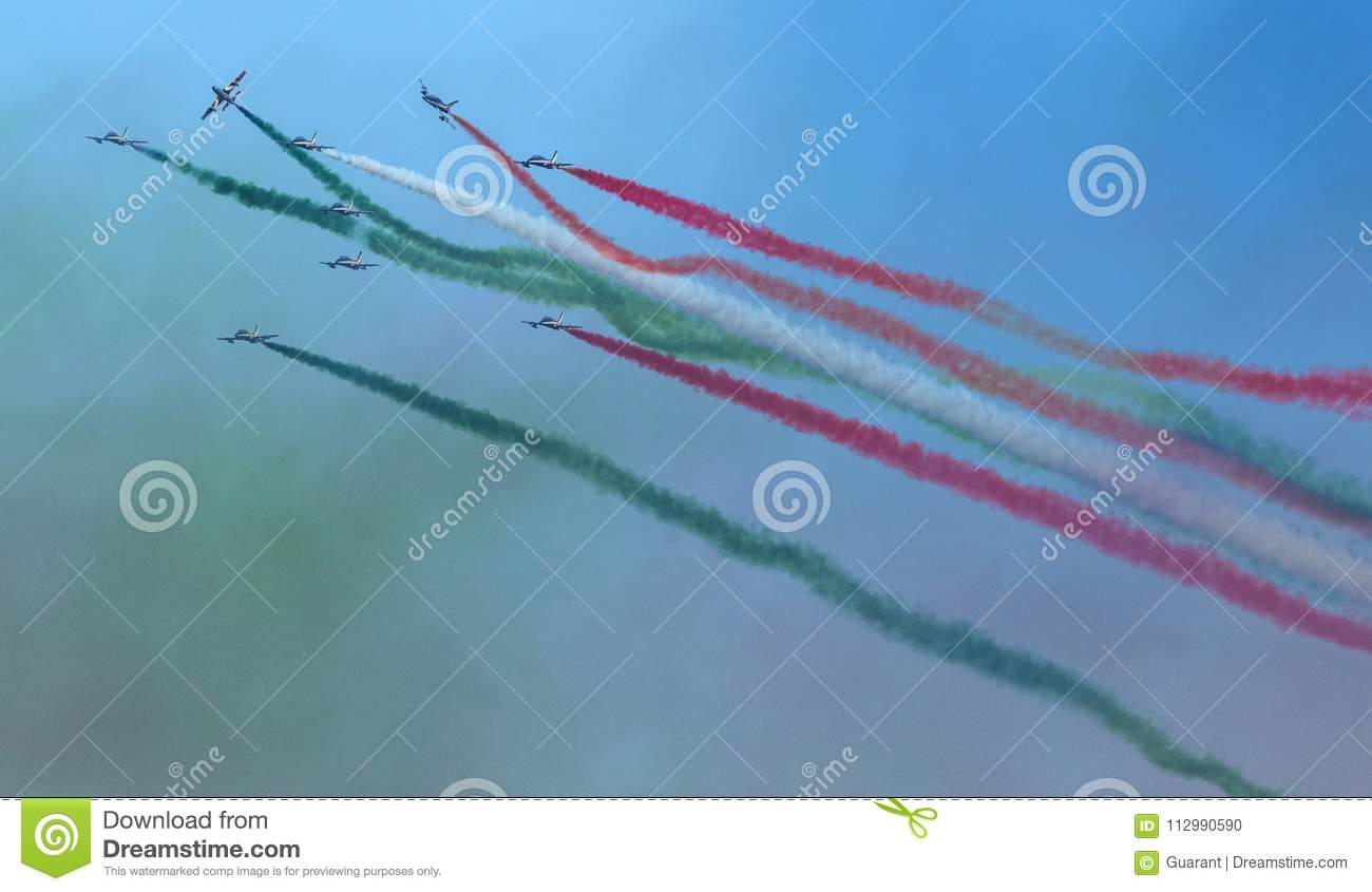 Planes jet of Italian tricolor arrows in acrobatic team during air show, in a spectacular acrobatics