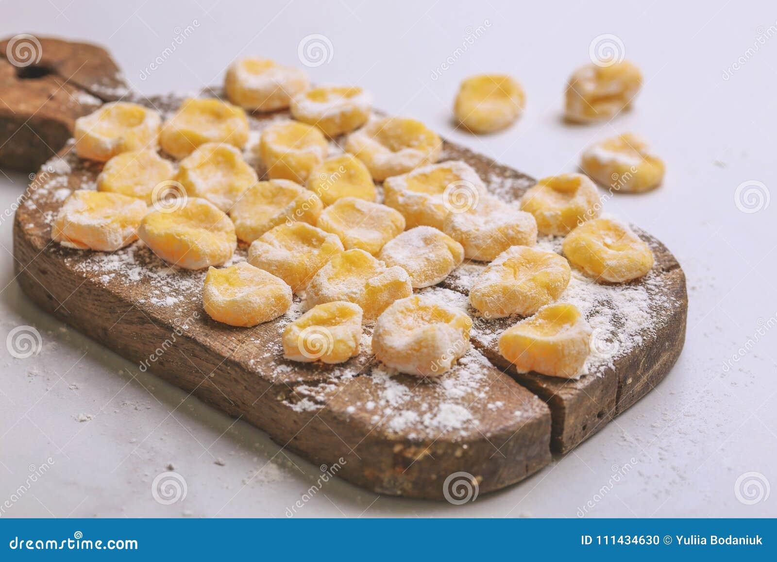 Italian uncooked homemade potato gnocchi with flour.