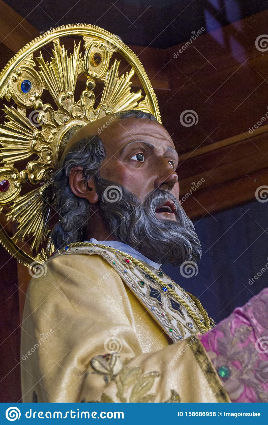Italy. Bari. Popular devotion. The precious wooden simulacrum of St. Nicholas of Bari kept inside the basilica dedicated to him