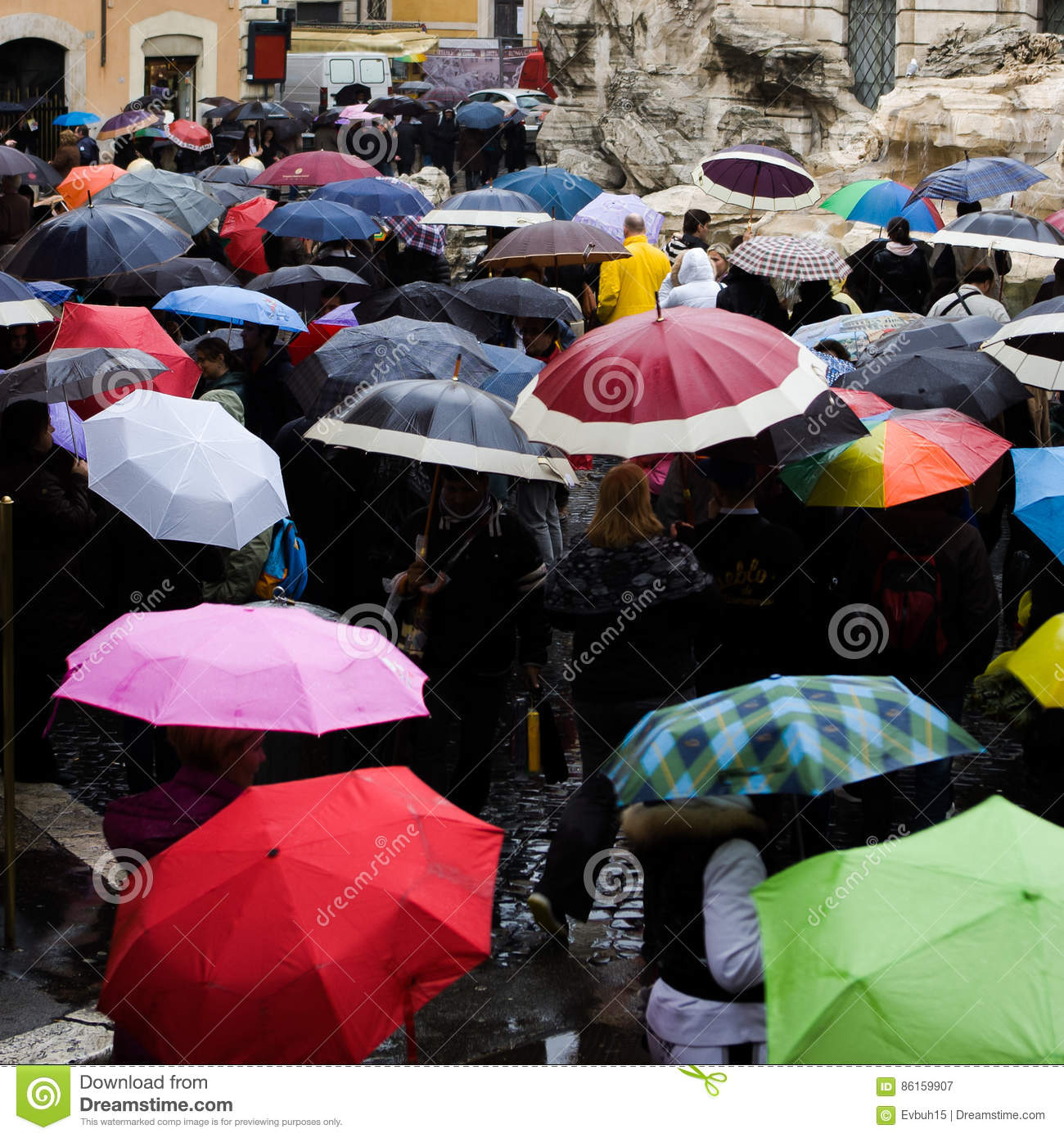 48a9ac2eb Italy, Rome - September 2016: Crowd with umbrellas is standing near Trevi  fountain.