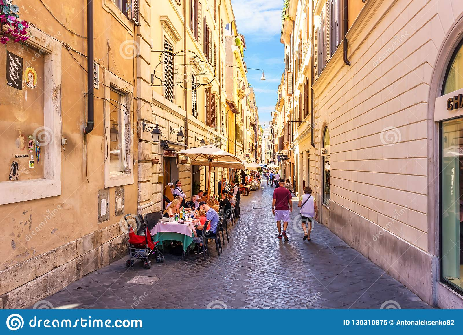 Italy street cafe in Rome street Via delle Carrozze near the Chanel boutique