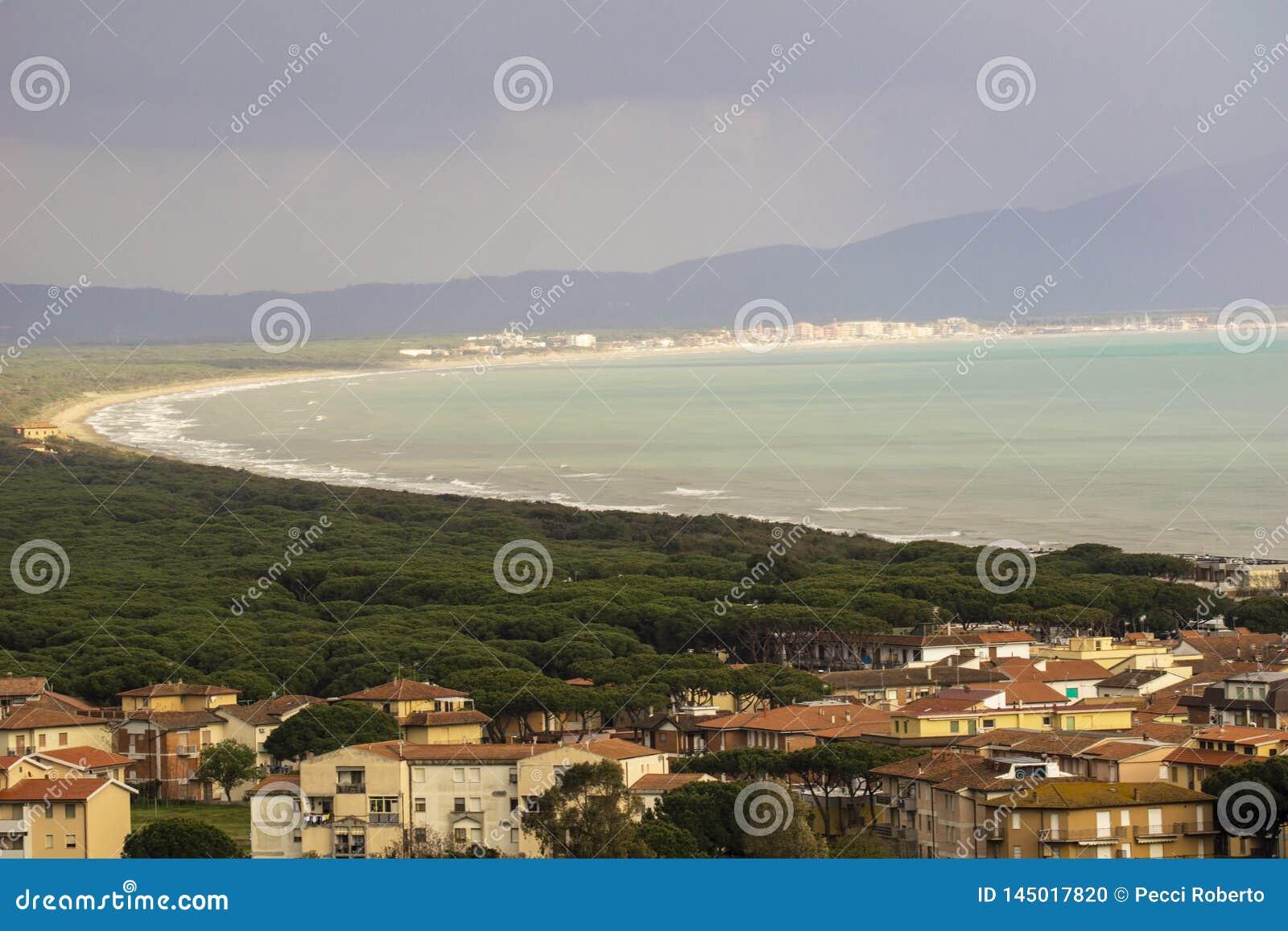 Italy, Tuscany, Castiglione della Pescaia, panoramic view of the coastline from the top