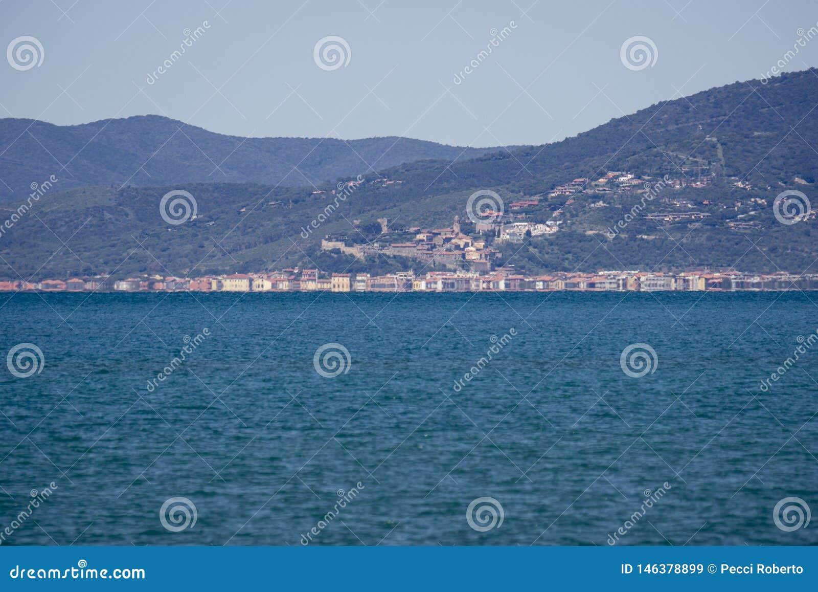 Italy Tuscany Maremma, on the beach towards Bocca di Ombrone, view of the coast line, in the background Castiglione della pescaia