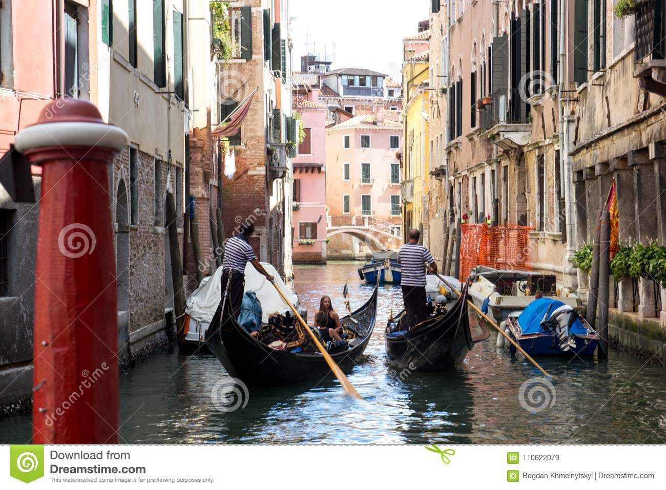 ITALY, VENICE, 18,09,2017, Two gondolas with people sail through