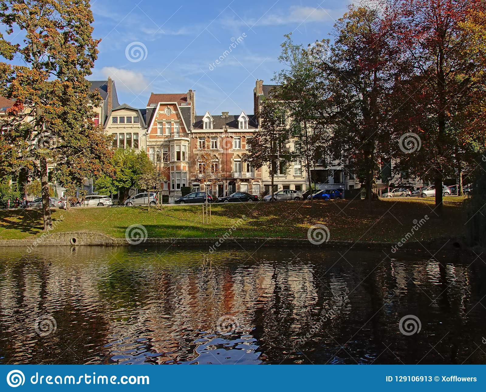Ixelles lakes with autumn trees and houses in art nouveau style
