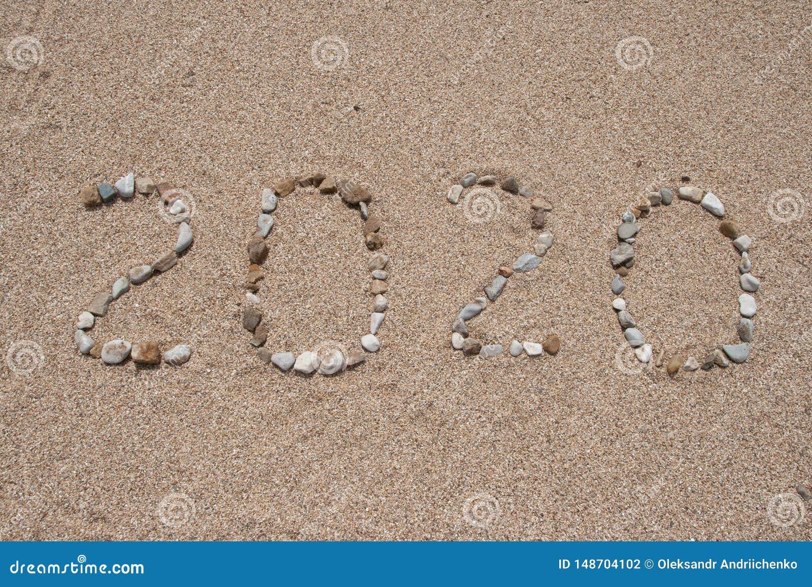 2020-jähriges geschrieben auf den Strandsand