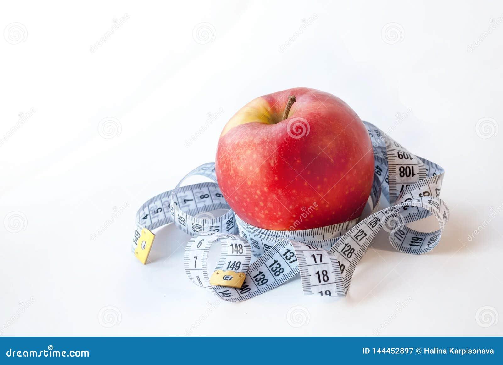 Jabłczanego tła pomiarowy czerwonej taśmy biel pojęcie diety