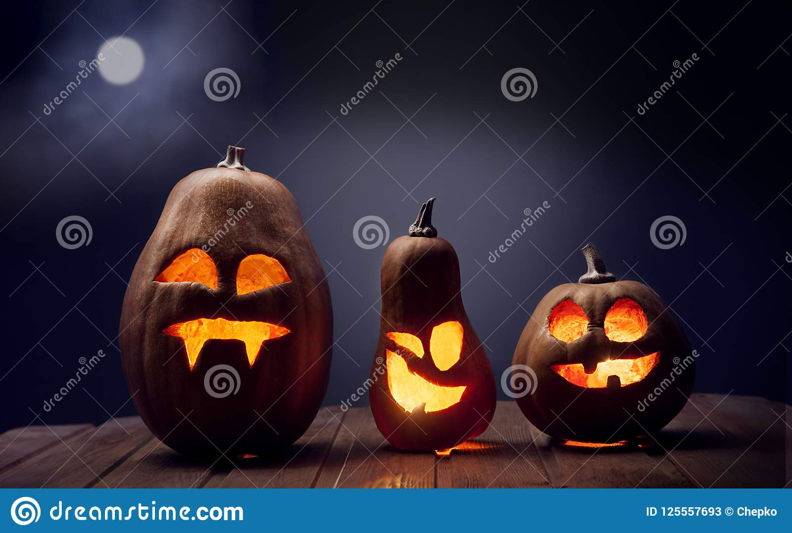 Download Jack O Lanterns Halloween Pumpkin Face On Wooden Background Stock Image - Image of lantern, autumn: 125557693
