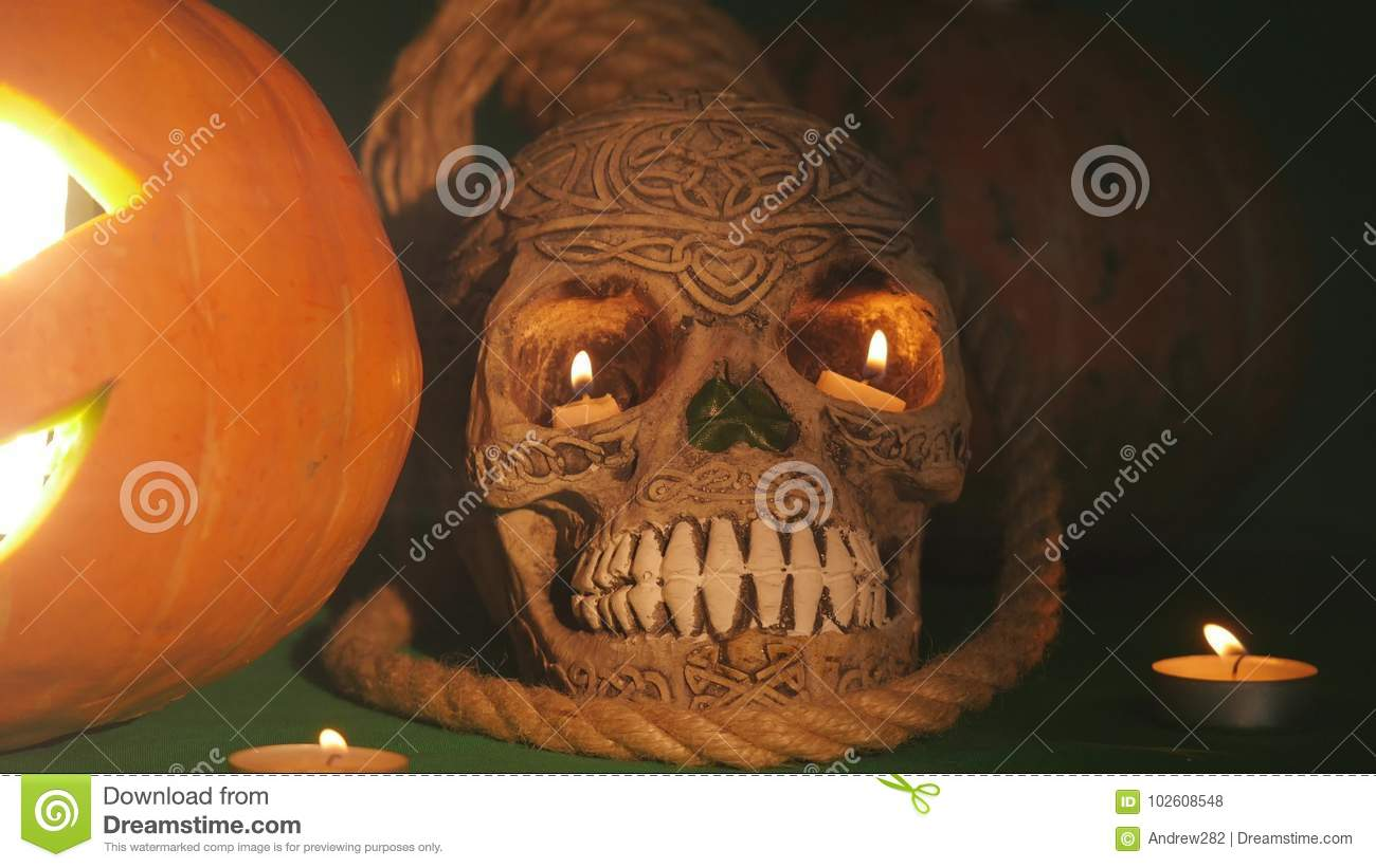 jack o`latern and skull.this high definition footage would fit