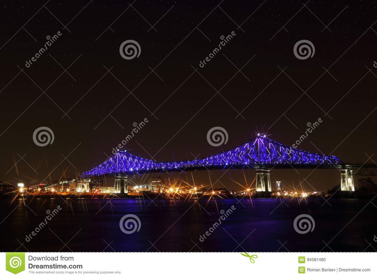Jacques Cartier Bridge Illumination in Montreal, reflection in water. Montreal's 375th anniversary.