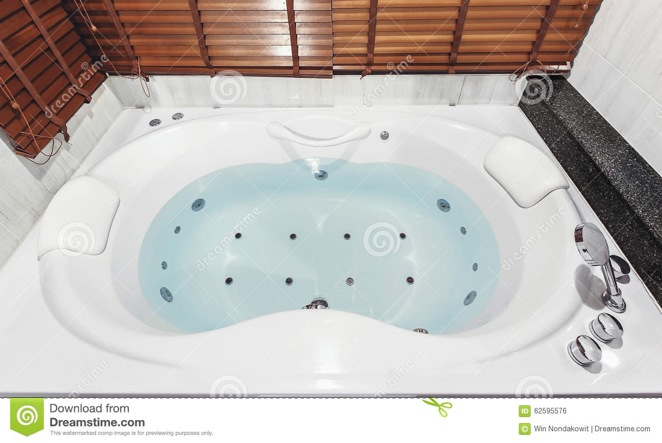 Jacuzzi bath tub stock photo. Image of facility, bath - 62595576