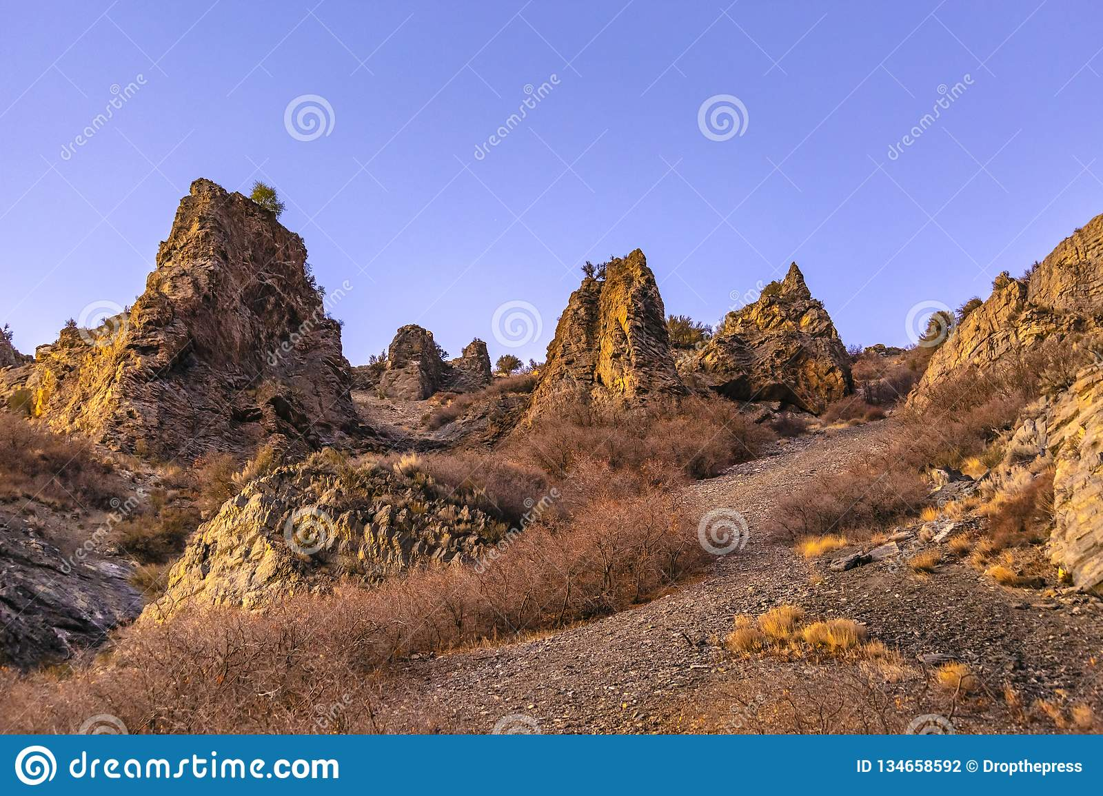 Jagged and rocky mounds on the side of a mountain