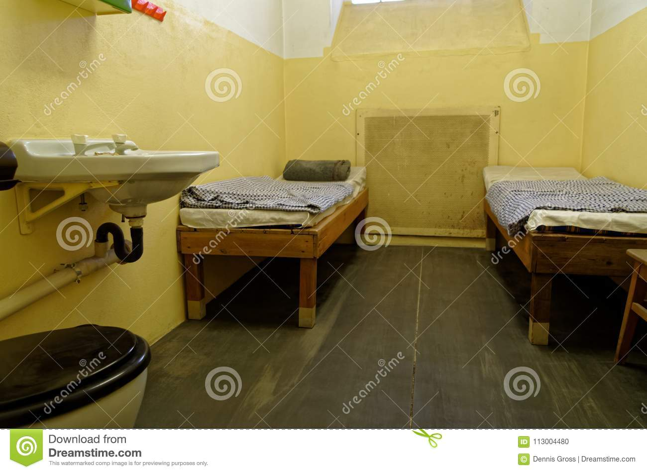 Jail Cell With Two Bunk Beds And Sink Are Exposed In The Stasi