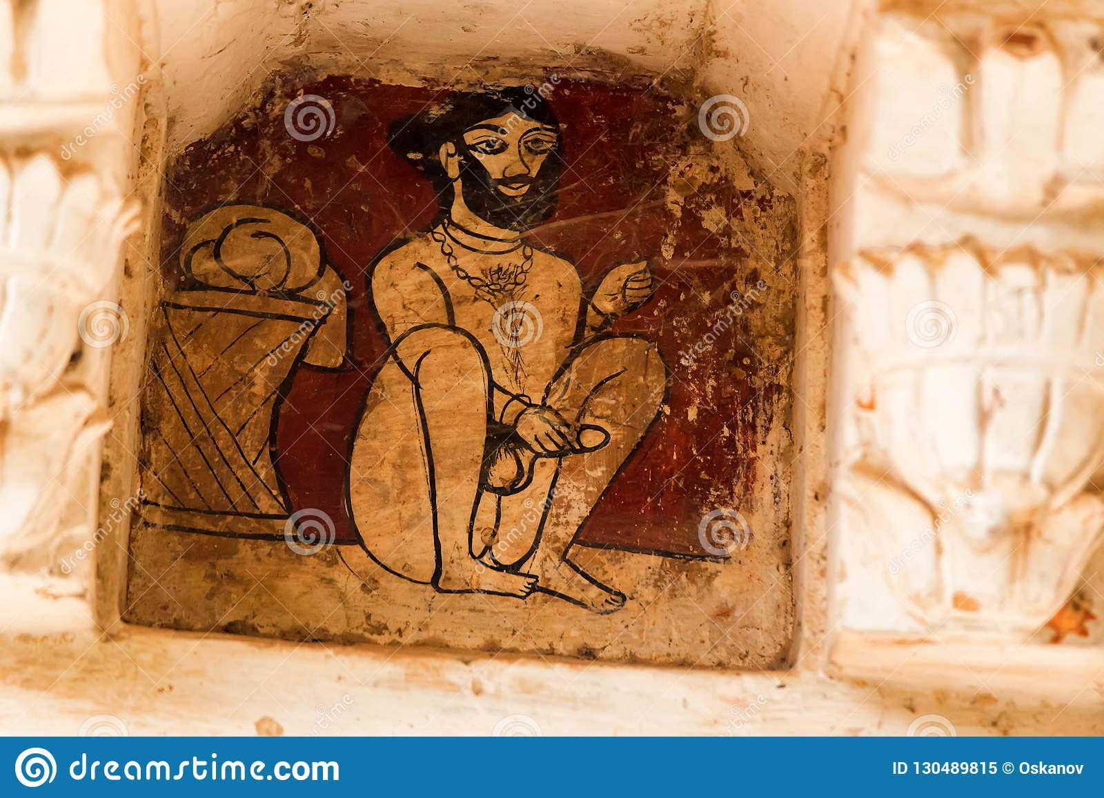 JAIPUR, INDIA - NOVEMBER 5, 2017: Kamasutra or ancient sex images on wall  in Indian Palace in Amber Fort. Kamasutra is an ancient Indian Hindu text  written ...