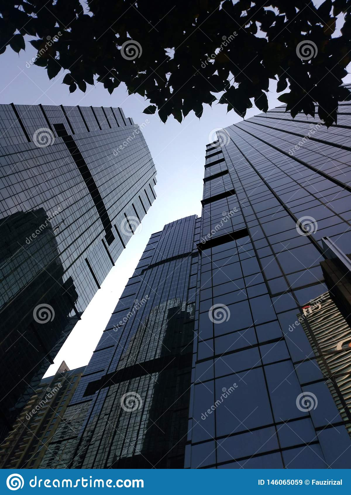 Jakarta building view with morning Blue sky. Low angle jakarta building view