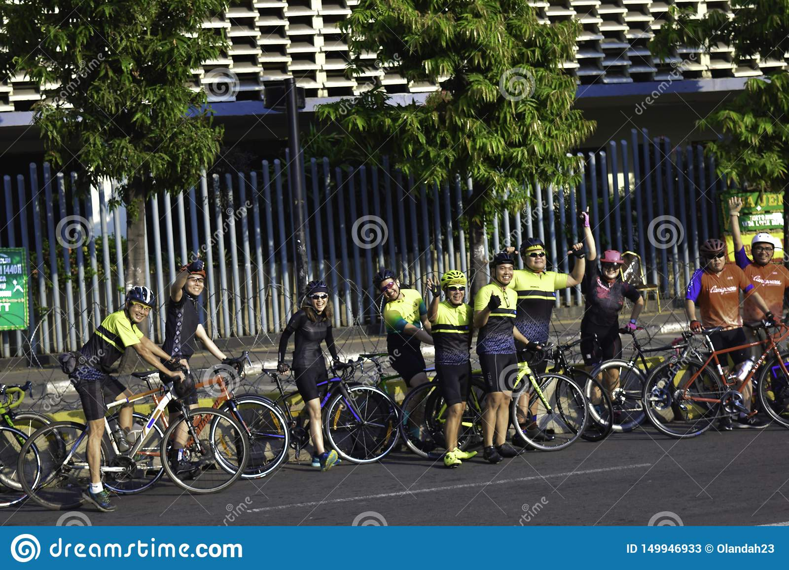 Healthy lifestyle - group people riding bicycles in city at the weekend