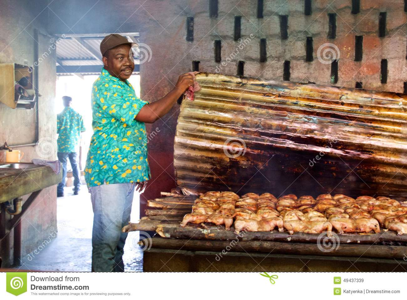 Jamaican cook showing jerk chicken cooking editorial stock image jamaican cook showing jerk chicken cooking forumfinder Choice Image