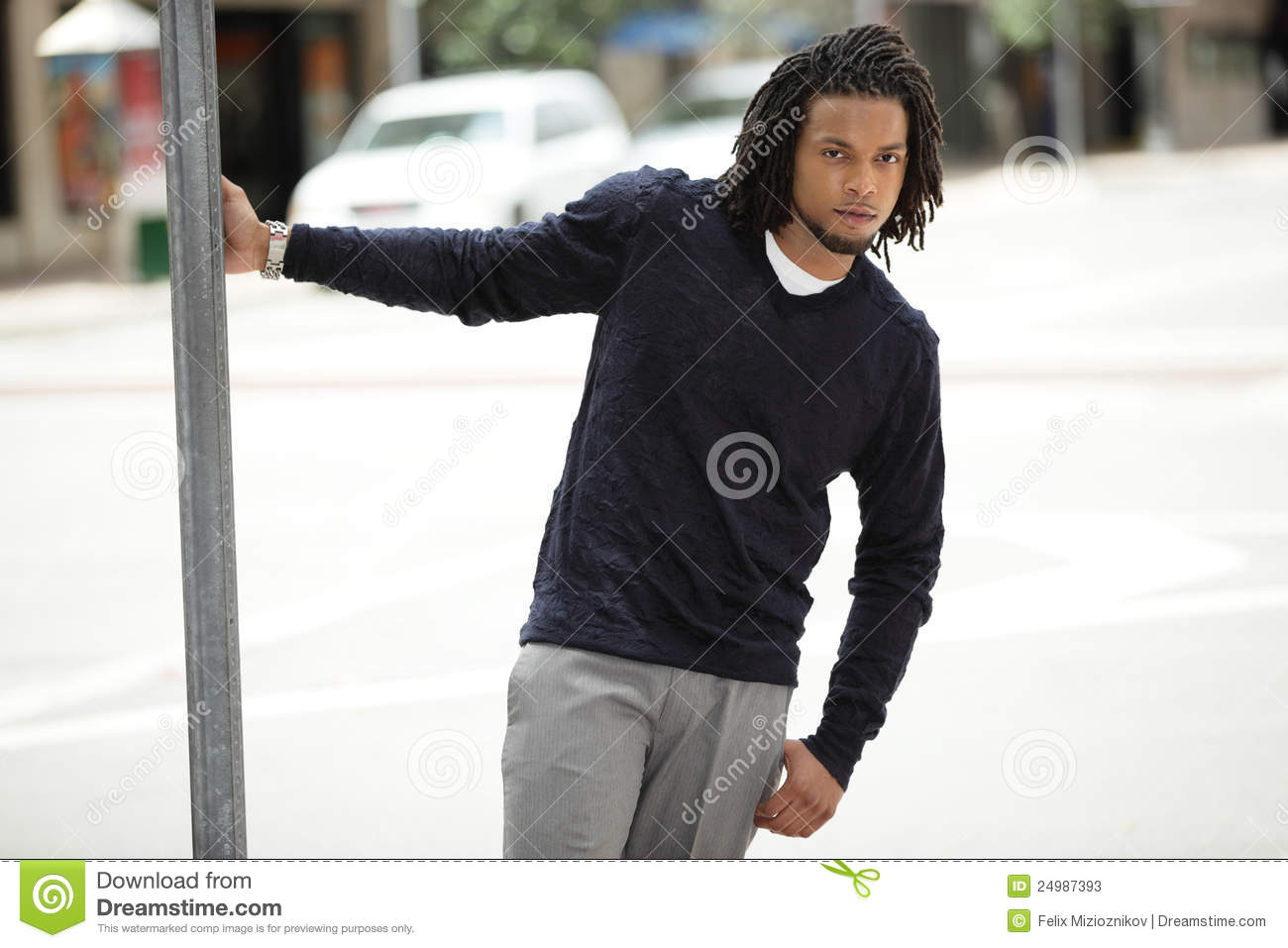 jamaican man hanging from a pole stock image