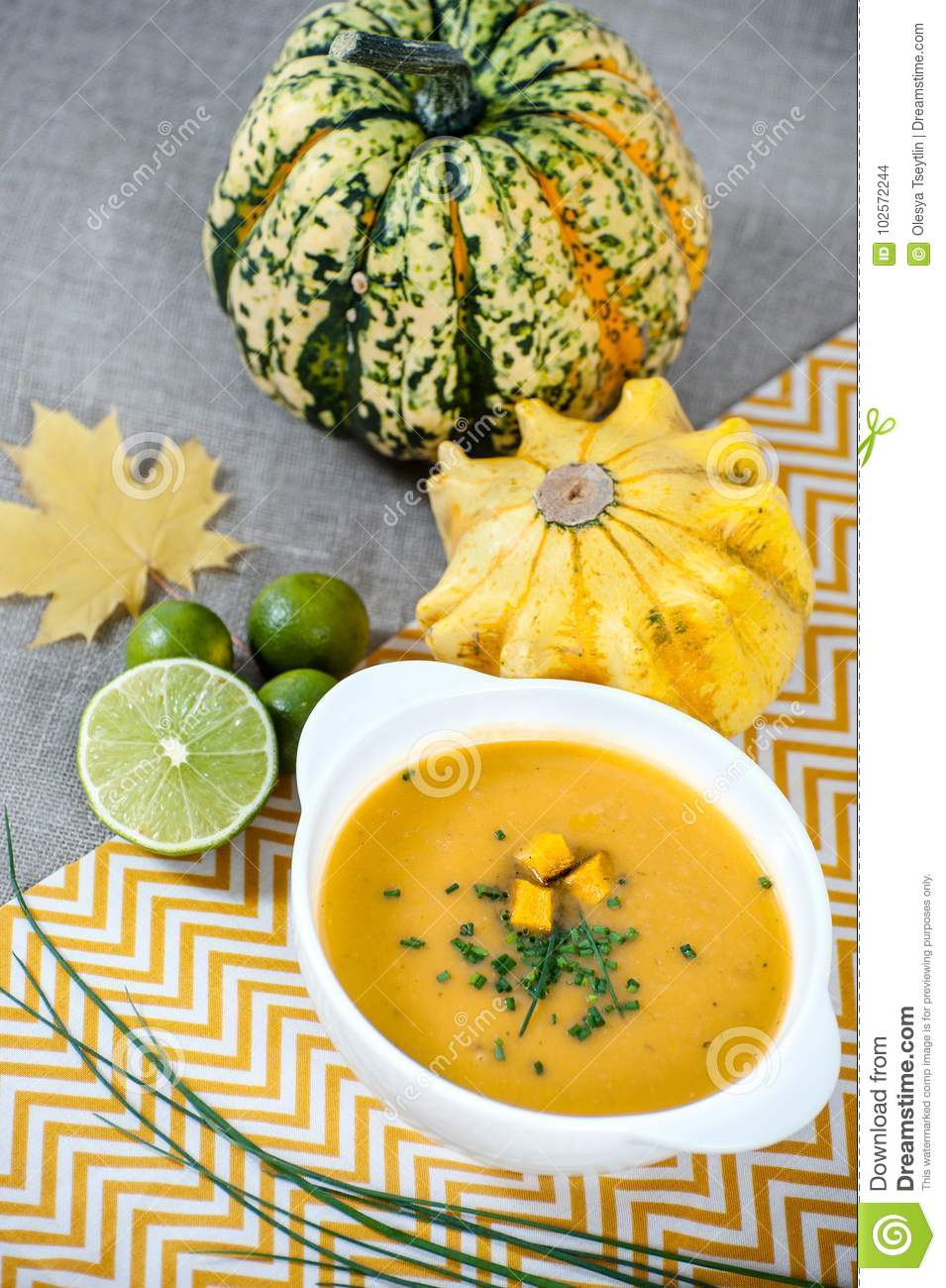 jamaican pumpkin soup with lime in a white stylish plate