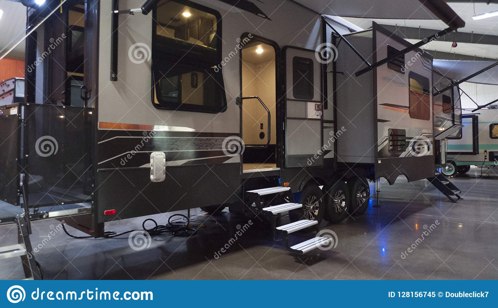 Toy Hauler RV Camper In Showroom Editorial Image - Image of