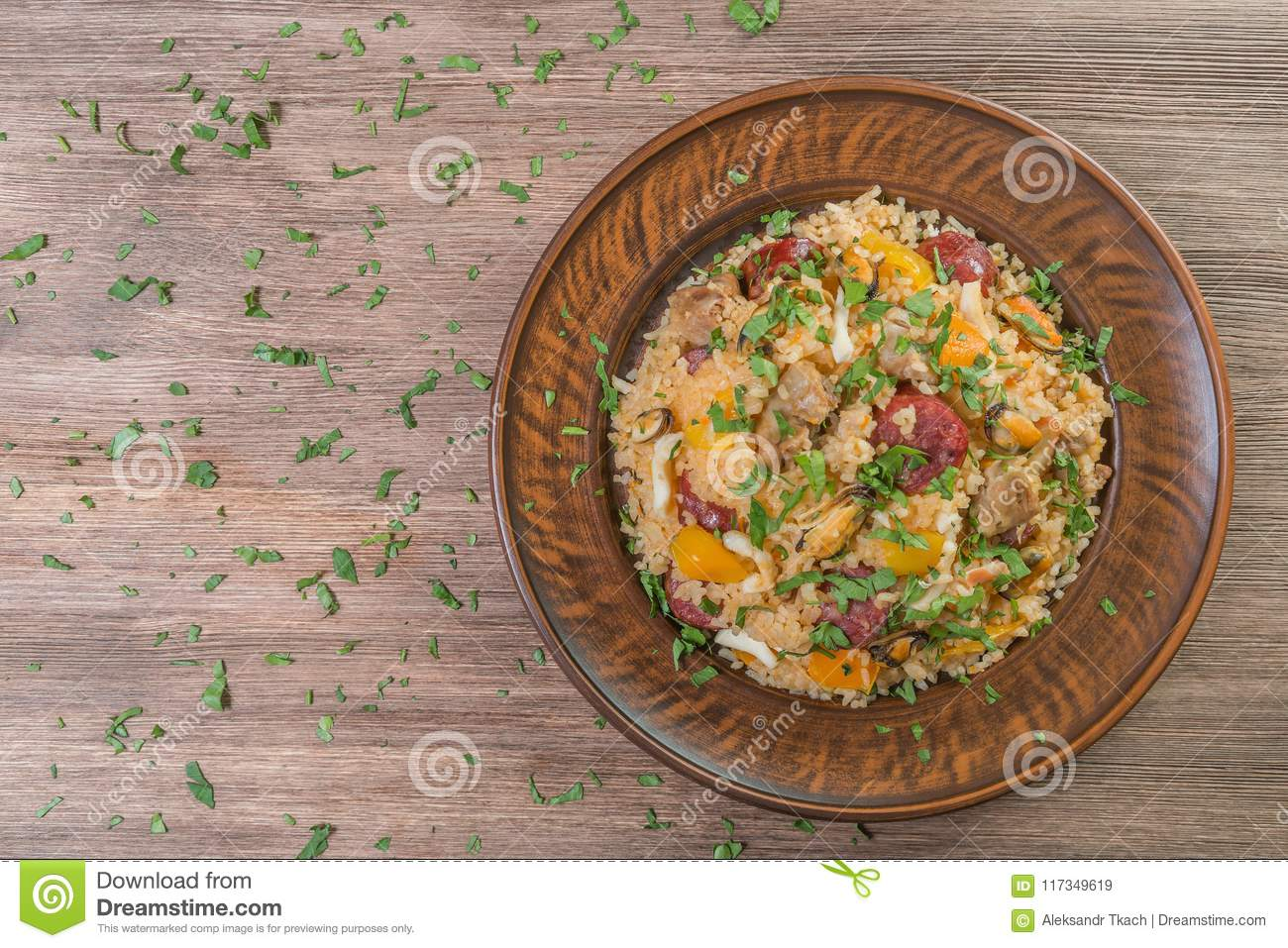 Jambalaya in a ceramic plate. The national dish of the United States. The view from the top. Close-up.