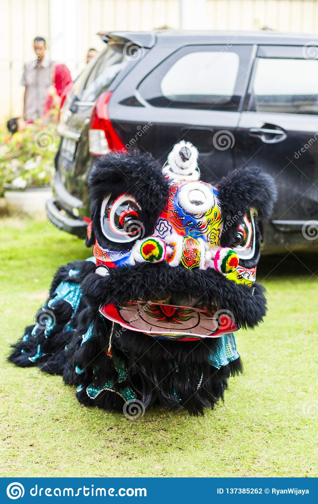 Jambi, Indonesia - January 28, 2017: Lion dance doing acrobatics to celebrate Chinese New Year