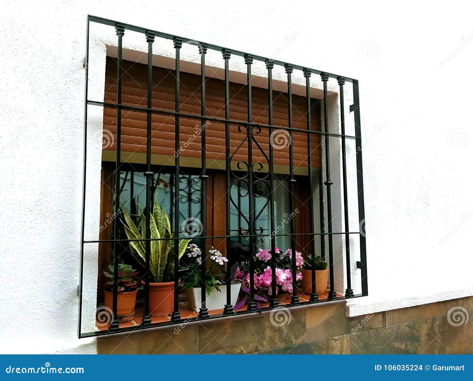 Janela com barras e potenciômetros de flor