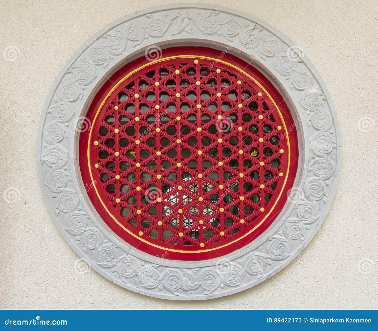 Janela do chinês tradicional da parede de pedra