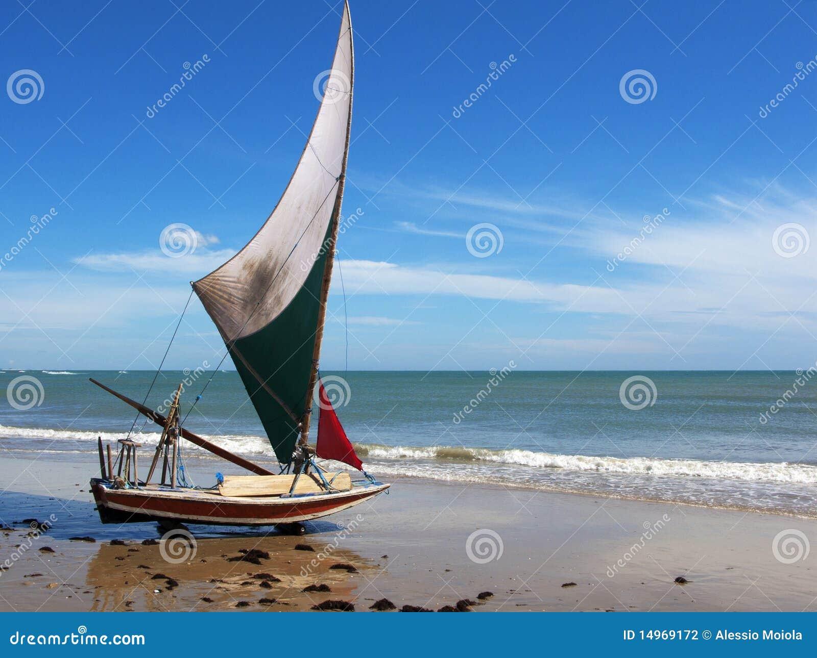 Jangada small sailboat on the beach, Brazil
