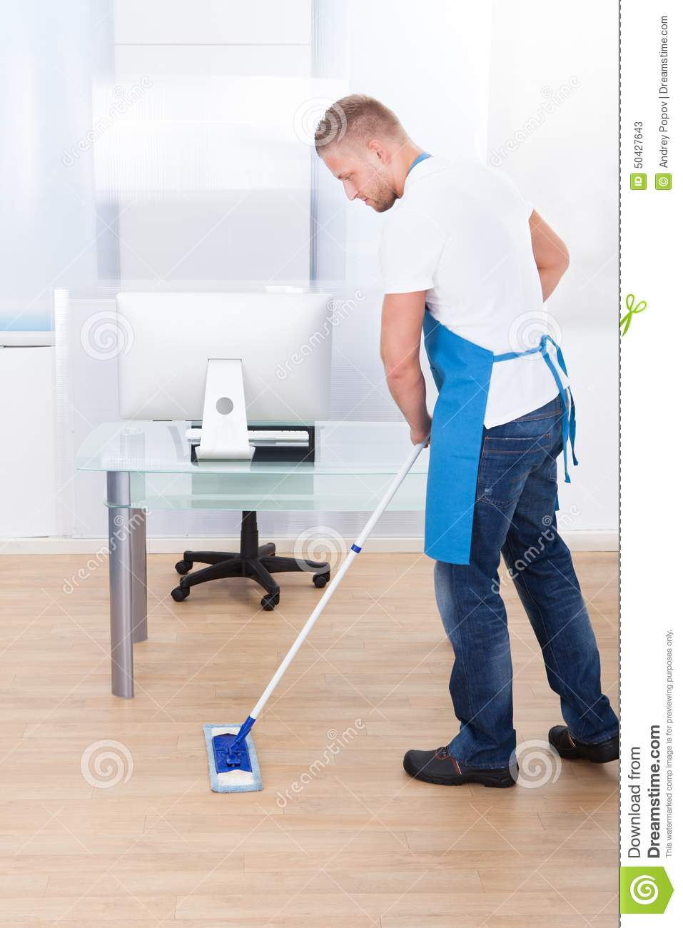 Janitor Cleaning The Floor In An Office Building Stock