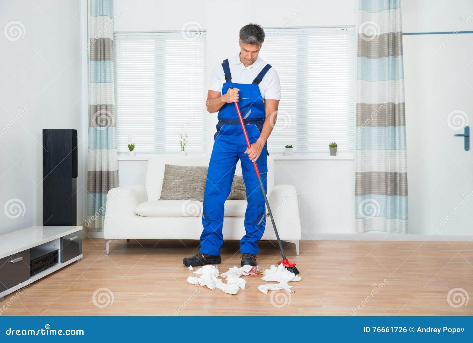 Man Sweeping The Living Room Stock Photo Cartoondealer