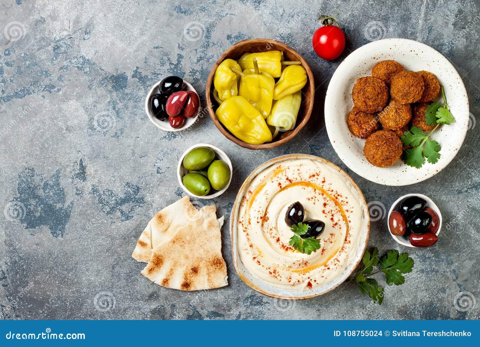 Jantar tradicional do Oriente Médio Culinária árabe autêntica Alimento do partido de Meze Vista superior, configuração lisa, aére