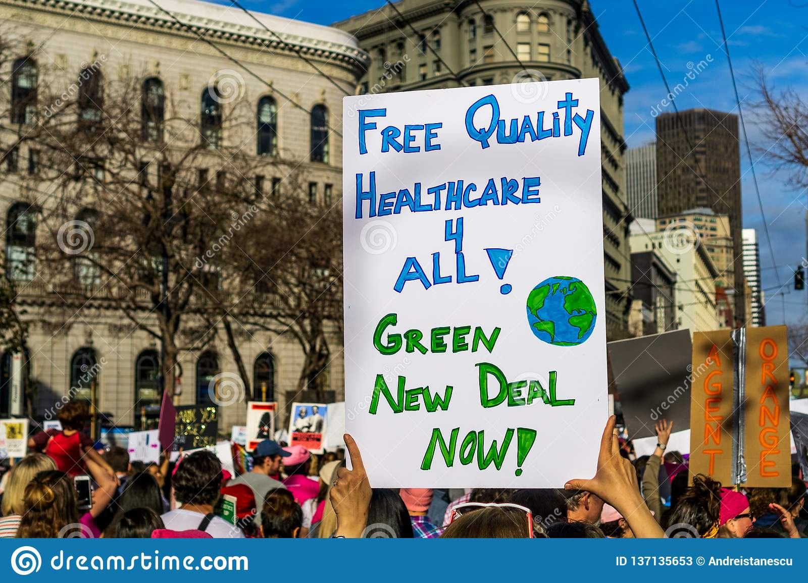 January 19, 2019 San Francisco / CA / USA - Women`s March Free Healthcare and Green New Deal sign