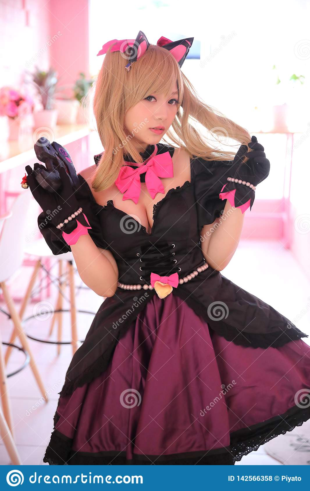 Japan anime cosplay, portrait of girl cosplay in pink room background