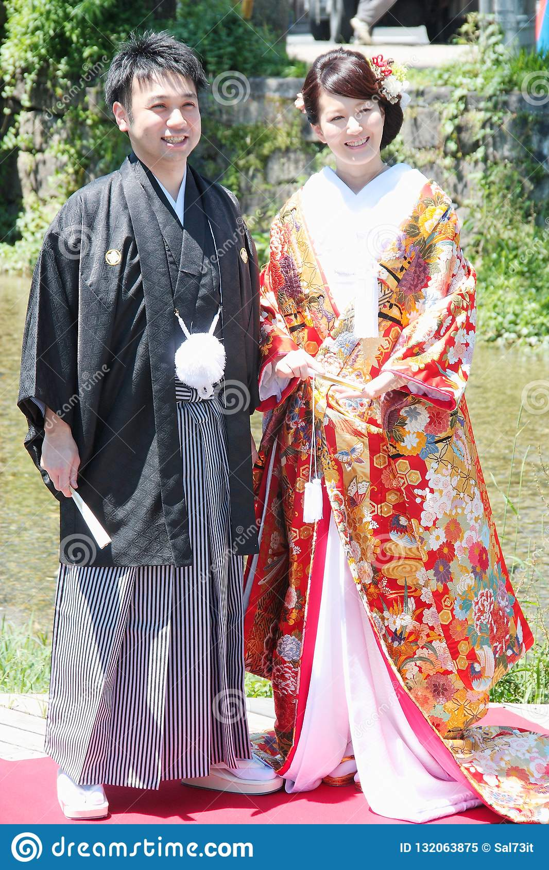 Beautiful bride and groom wearing traditional japanese wedding dress in Kyoto Japan.