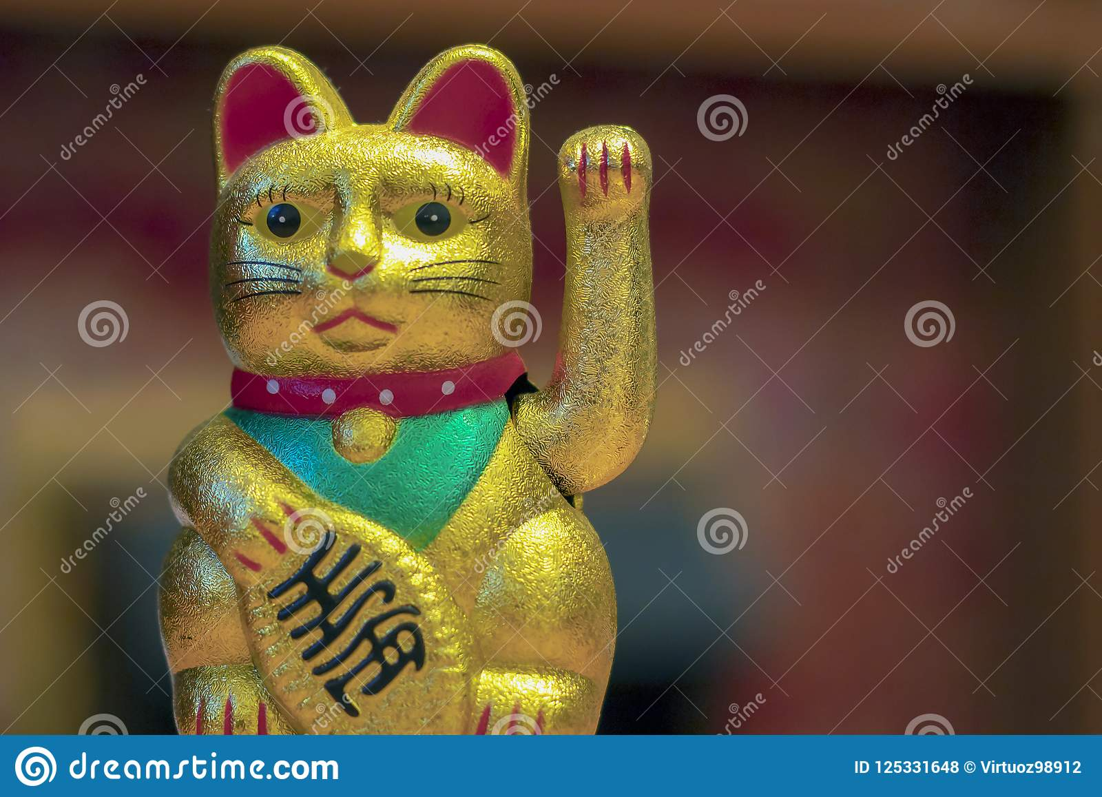 Japan lucky cat or Maneki Neko with Japanese characters mean Goo