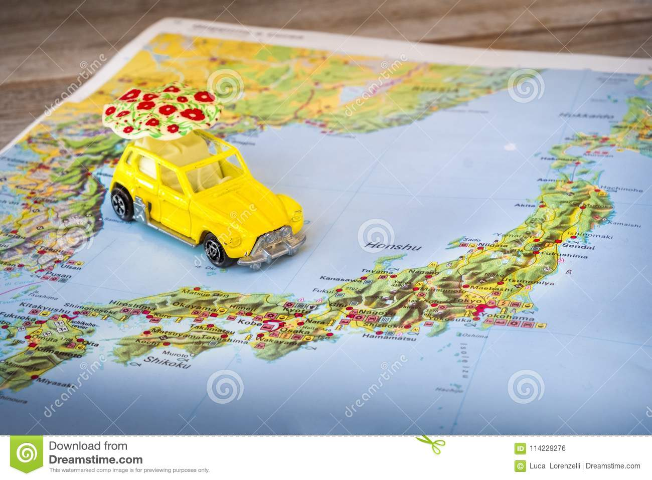 Japan map paper yellow beetle toy car background
