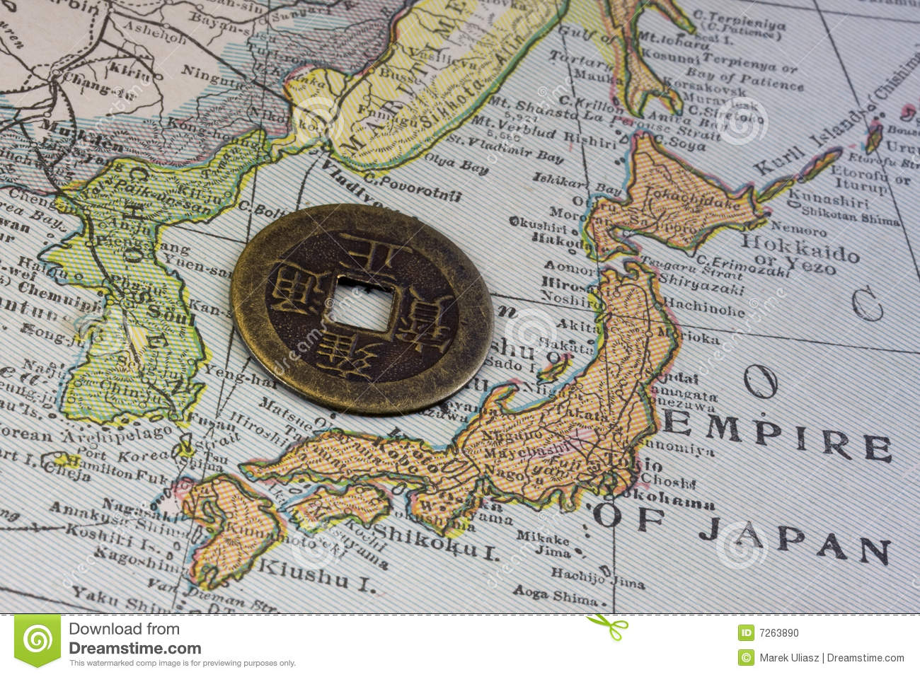 Japan on vintage map and old coin
