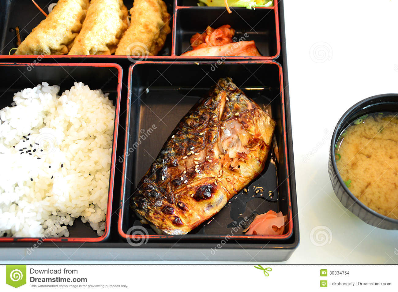 ... bento with grill saba fish and miso soup isolate on white background