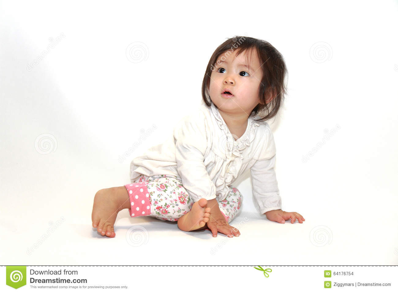 Japanese baby girl sitting on the floor stock photo for On the floor