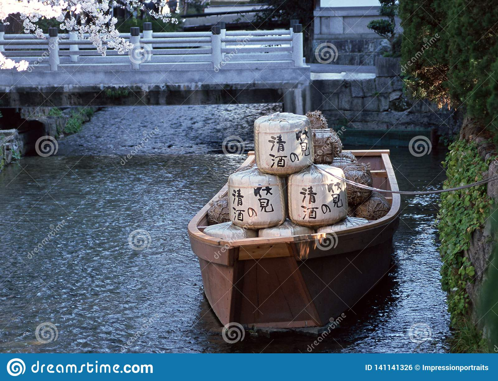 Japanese boat with goods in a river tied to the bank with a rope background