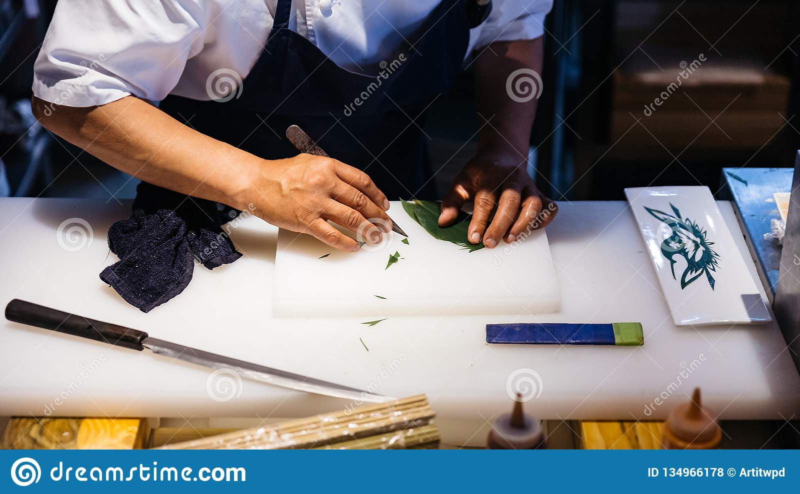 Japanese Chef Created Leaf Art By Knife Cutting A Leaf For Decorate A Meal On White Plastic Chopping Board Stock Photo Image Of Nutrition Health 134966178