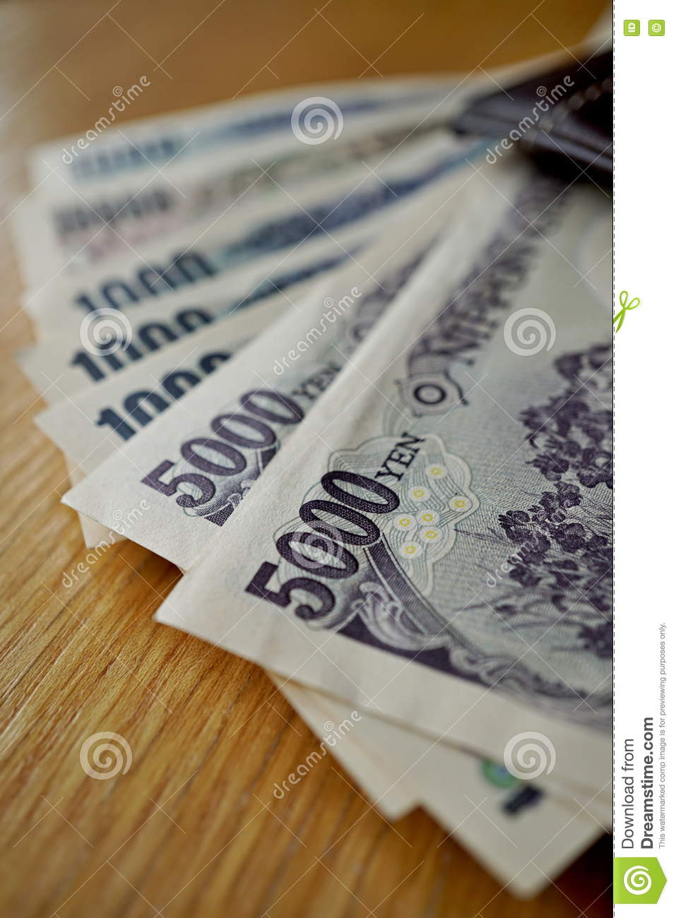 Japanese Currency Yen With Its Asian Symbols In Form Bank Notes On