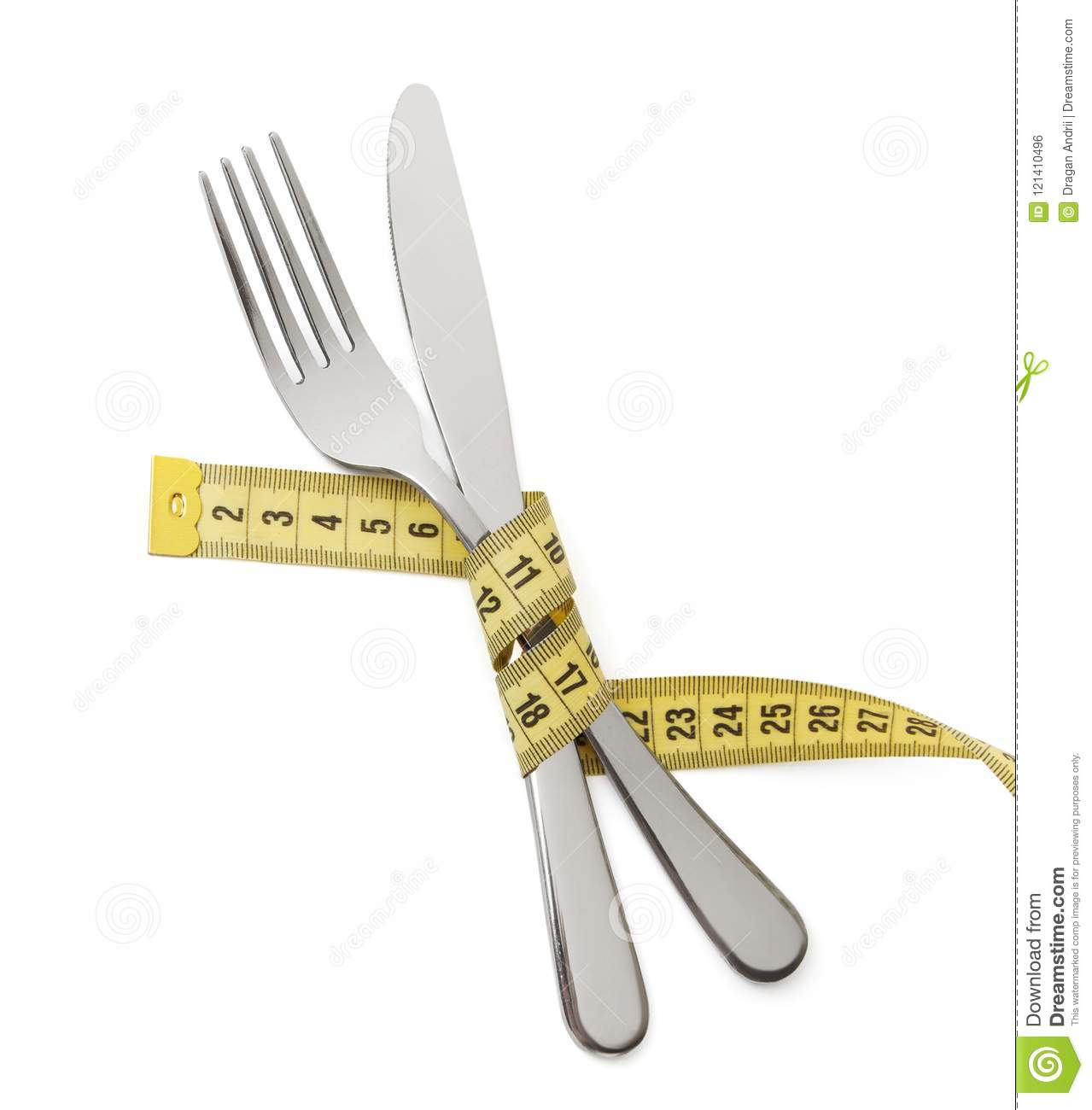 Japanese diet for weight loss. The fork and knife are wrapped in yellow measuring tape on white isolated
