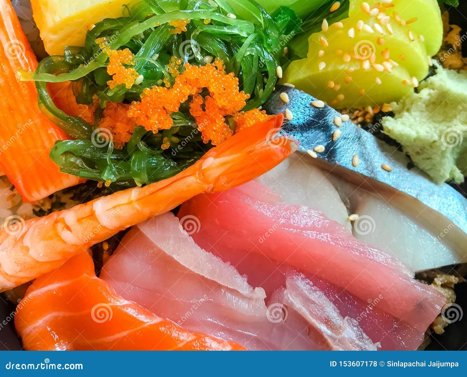 Japanese food sashimi. Mixed sliced raw fish set. Salmon fish, Tuna fish, Saba fish, Salmon roe, Crab sticks, Tamago sushi.