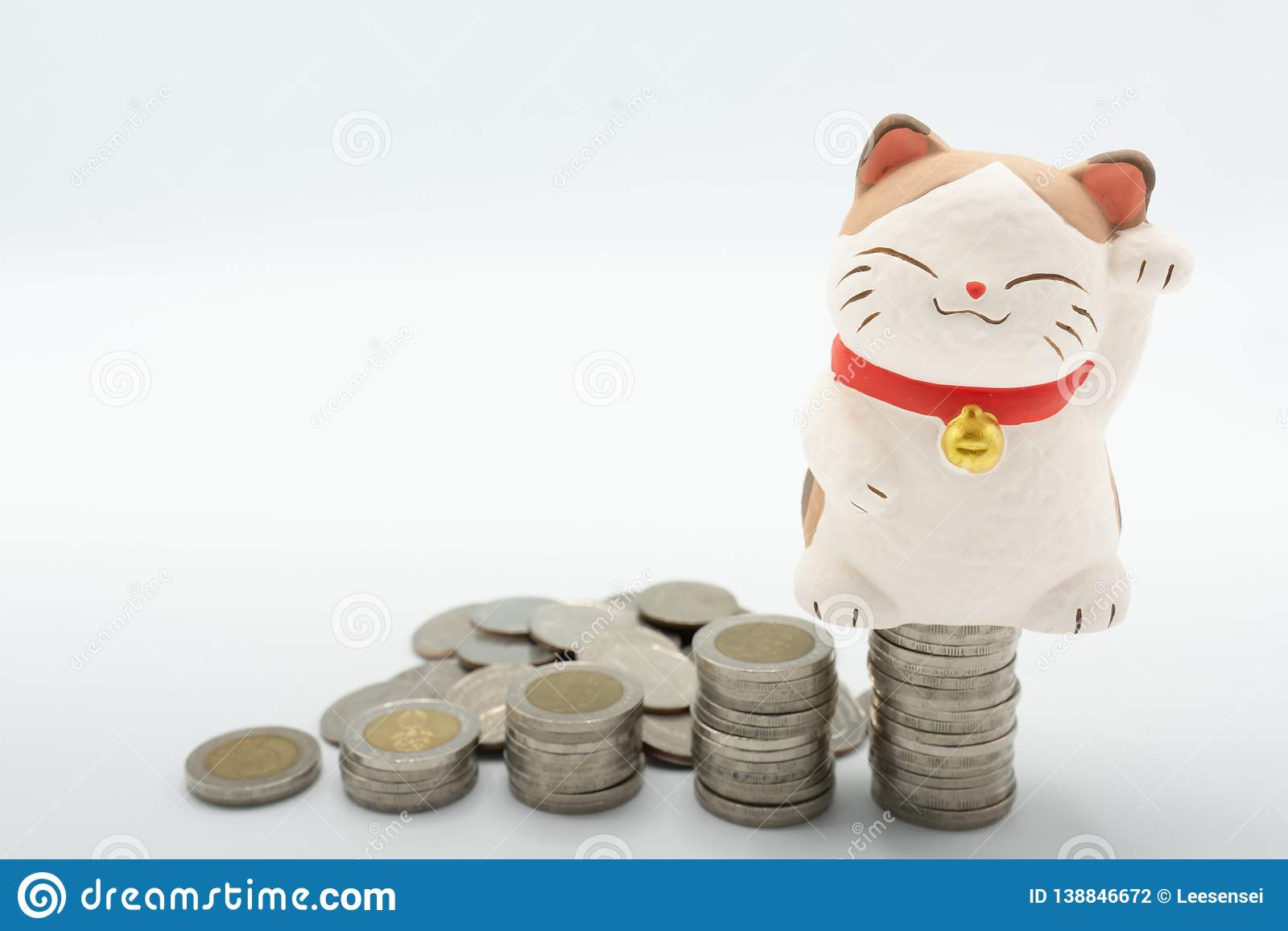 Japanese fortune wealth cat figure Maneki Neko with stacking coins