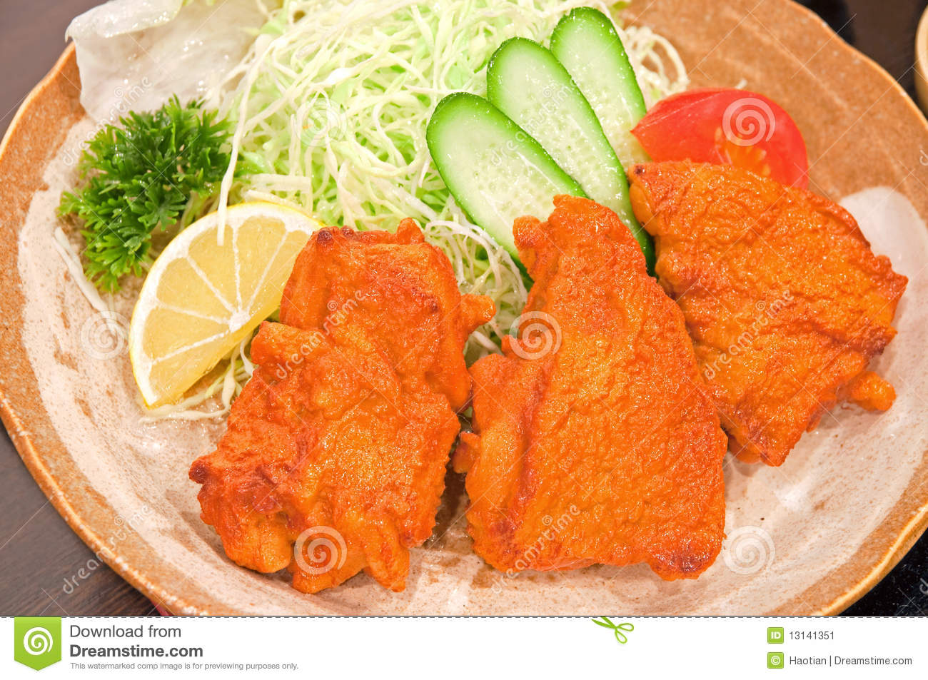 Japanese style fried chicken with simple salad.