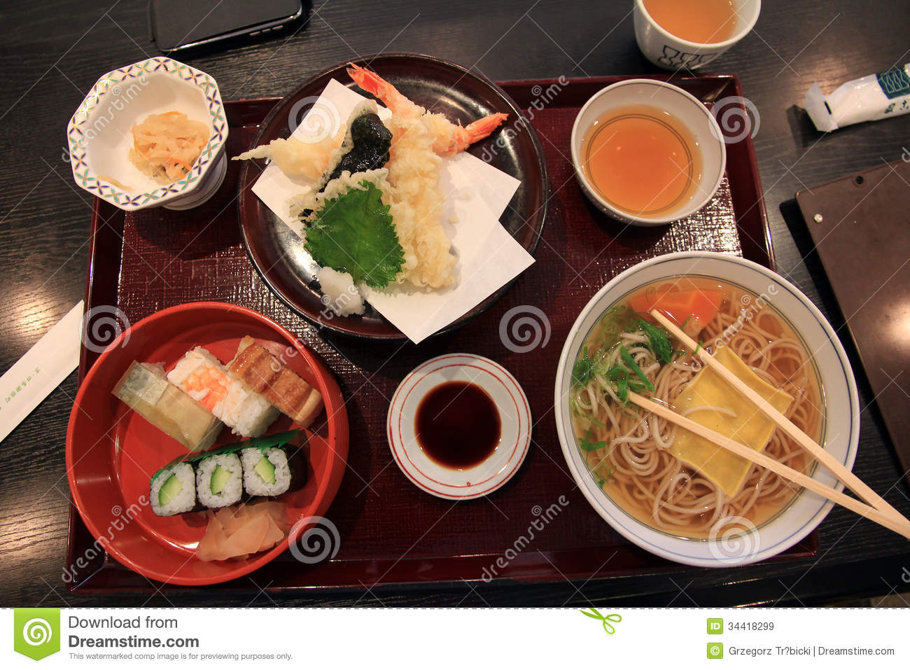 picture of a japanese lunch set including tempura, ramen and sushi.